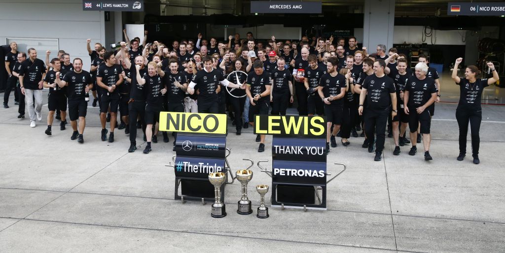 Mercedes celebrate the win and their 3rd Constructor's title